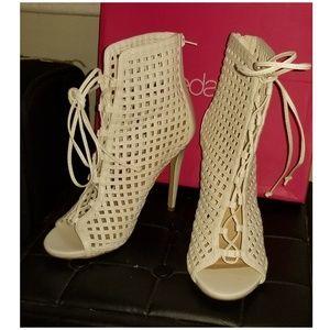 Open toed, laced heels